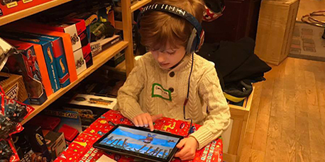 Kid playing online games - Spin Me a Tale Personalized kids books